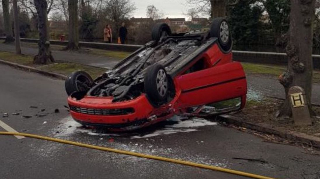 Man held after car with baby inside flips in six-vehicle collision