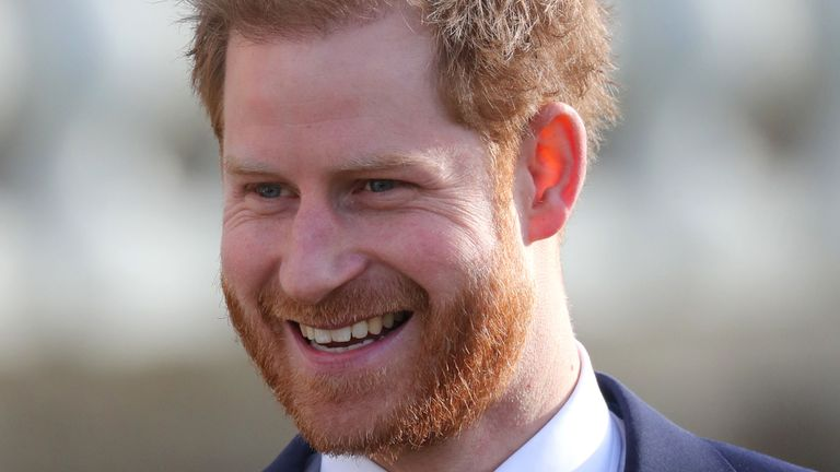 Smiling Harry back at palace for first royal engagement since crisis